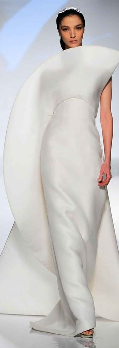 Fausto Sarli. The white of skim milk. True Summer. For being simple, sculpted, asymmetric, and smooth, I think of Dramatic. There's some Yin here, but maybe that's because a woman's body is wearing it and it is a wedding dress (or it sure looks like one).