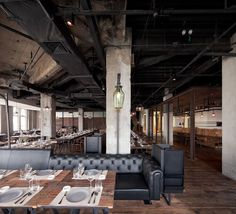 Mercato Restaurant by Neri in Shanghai, China. Raw building contrasted with modern furnishings