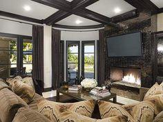 Khloe Kardashian mounts her TV over the fireplace!