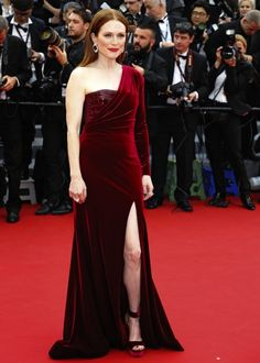 Julianne Moore at the Premiere of Mad Max: Fury Road. Julianne had us crushing on velvet in a red custom Givenchy gown. Chopard gems and coordinating velvet sandals finished off her ensemble.