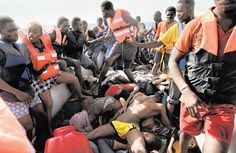 "October 6, 2016 ARIS MESSINIS/AGENCE FRANCE-PRESSE — GETTY IMAGES Witness to a Perilous Crossing ""I've seen a lot of death, but not this thing,"" Aris Messinis, an Agence France-Presse photographer, said of boats packed tight with African migrants. In one, migrants had to climb over the dead. Many were in the cargo hold, an image evoking the slave trade. Page A11."