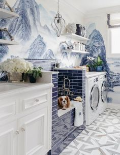 Love the floor tile and wallpaper in this luxe laundry room