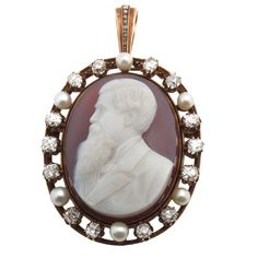 Gold, Hardstone, Pearl and Diamond Cameo  Russia  1880-1910s  Amazing rose gold (12 1/2-13kt) Russian stone cameo of Tolstoy. 7 carats of old European cushion cut diamonds with pearls. Can be hung as a pendant or used as a brooch.