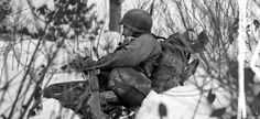Portrait of misery: A 90th Infantry Division soldier with a Browning Automatic Rifle waits in the snow and sub-freezing temperatures near Doncols, Luxembourg, for a possible enemy attack, January 1944.