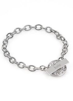 Our Personalized Rhinestone Toggle Bracelet is absolutely darling. This rhodium finished bracelet featuring a circular rhinestone toggle charm is an excellent gift for all the women on your list. Whether youre dressing up or dressing down this sparkling bracelet will look fabulous with all your clothing options. Includes a free organza gift pouch.  Features and Facts:  Size: Measures 7 1/4 inches long.  Materials: Rhodium finished setting and rhinestones.