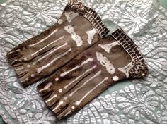 Hand-embroidered, tea-dyed and batiked bone gloves by Joy Patterson for Twixt Piety and Desire