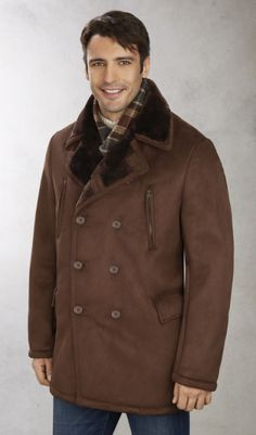 "Faux Shearling Double Breasted Pea Coat - Walk out in style this winter in this double breasted faux shearling 32"" coat. It looks very close to the authentic shearling and its dressy style makes it perfect for both office wear and for evening events. You can also have a casual look too if you pair it up with a pair of jeans. Features a six button front and two side convertible pockets. Versatile and chic, you cannot look for a better piece of outerwear to go with your winter wardrobe."