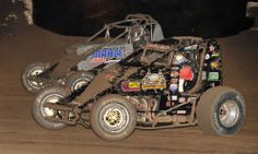 Dave Darland (71p) battles Chad Jones  during AMSOIL USAC National Sprint Car Series action at Riverside Int'l Speedway in Arkansas. (Dave H...
