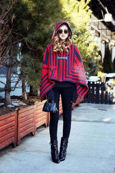 hooded poncho with jeans and pointed boots