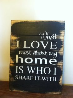 "Was 39.00 Now 19.50 What I love most about my home is who I share it with 13""w x17 1/2""h Hand-painted wood sign"