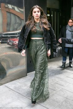 Top of the crops! Hailee Steinfeld flashed her midriff in a green crop top and long flowing trousers when she stepped out in New York on Tuesday
