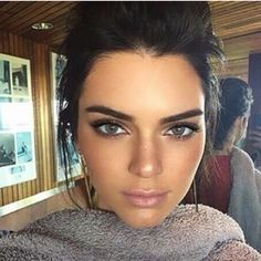 Kendall Jenner looking awesome in blueish-grey contact lenses!