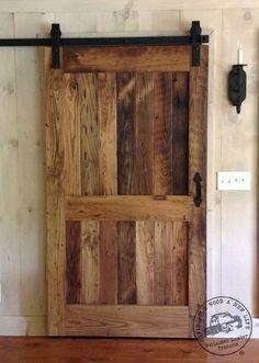 reclaimed chestnut sliding barn door with flat track hardware