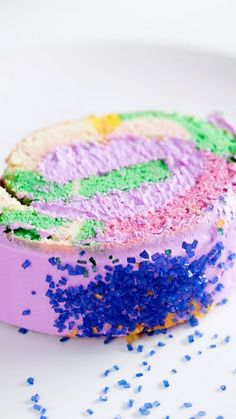 Get into the Mardi Gras spirit with a vibrant king cake roll filled with purple frosting and, yes, a plastic baby.