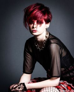 Vibrant red coloured hair.   Black Flag by Nelson Brown.