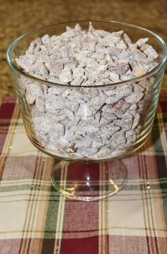 """Nutella """"Puppy Chow"""" Snack: 1 1/2 c. Nutella, 2 tbsp butter...melt, pour over Chex, shake in powdered sugar (but I think I'll use cake mix)."""