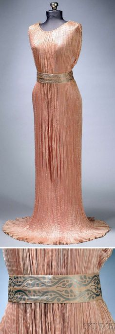 """""""Delphos"""" gown, Fortuny, Venice, ca. 1910. Tea pink pleated silk with clear beads across shoulders, around armholes, and down side seams. Three hand-decorated strips of fabric, or sashes, which vary in width"""