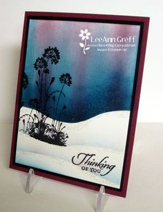 "By LeeAnn Greff. Mask ground & sponge sky. Use masks for snow hills, laying down a mask & sponging just a bit at the top edge of the mask. Lay down the middle snow hill mask again before stamping the image from ""Serene Silhouettes"" (Stampin ' Up) in black -- maybe use black VersaFine & heat emboss. Stamp sentiment in black also & heat emboss. Add black mat and card base. Pretty card!"