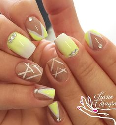 Beautiful and elegant looking yellow nail art design. The nail art design has a gradient inspired yellow to white combination as well as a nude polish as base topped off with white nail polish strokes and French tip designs in v-shape. For additional effect silver beads are also added on top.