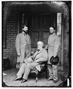 Robert E. Lee (seated) is pictured shortly after the War.  On the left of the picture is his son, General George Washington Custis Lee, and on the right is his chief of staff, Colonel Walter H. Taylor