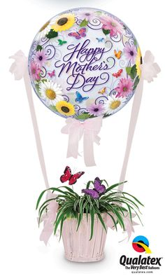 "Great gift idea - a Mother's Day ""hot air balloon"" featuring a Qualatex Bubble Balloon. Click through to search for a balloon delivery professional in your area."