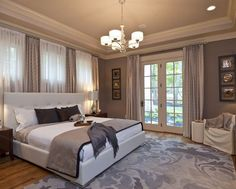 Great way to putting your bed against windows. Line the walls with drapery