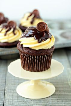 Chocolate cupcakes with a Rolo baked into the center, topped with caramel buttercream, finished with chocolate ganache and a Rolo.