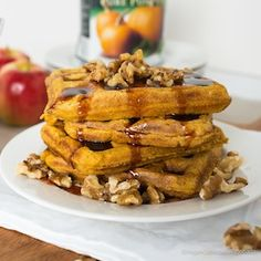 Warm, crisp, lightly spiced vegan pumpkin waffles topped in a rich sweet maple date syrup with just a hint of bourbon.