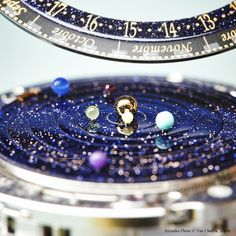 Van Cleef & Arpels Midnight Planétarium Poetic Complication timepiece, Poetic Complications™ collection #PoeticAstronomy #SIHH2014 Aventurine dial with six planets around the sun.