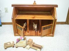 I was asked to make a Breyer Horse barn for my granddaughter last year. With no plans or pictures to go by, I put one of her Breyer horses on the workbench and built it to his scale. All of the wood came from Ella's great grandfather's (my dad) ba. Wooden Toy Barn, Wooden Diy, Miniature Horse Barn, Small Horse Barns, Horse Barn Plans, Farm Toys, Horse Stalls, Handmade Toys, Craft Projects