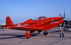 A Bell RP-63 Kingcobra in bright red.
