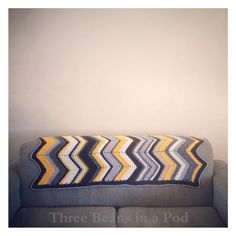 Nice color arrangement. I love chevrons, and they are so easy to crochet or knit. I think I even have yarn on hand to make this. I bought a bunch of greys & yellows to make an afghan last fall. Now to find the time (gotta finish up 2 more baby blankets first)