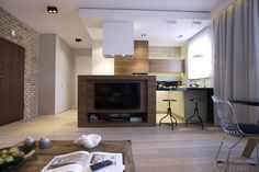 Clever use of space - kitchen island/TV wall