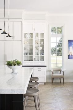 Clean and simple kitchen. Gorgeous floor! Wood floor, white kitchen, kitchen design