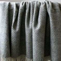 The Silkeborg Bornholm throw is made from undyed Scandinavian and Icelandic new wool with a diagonal stripe that's ideal for the sofa or draping over the bed. Odense, Cushions, Pillows, Scandinavian Design, Wool, Rugs, Blankets, Throw Pillows, Farmhouse Rugs