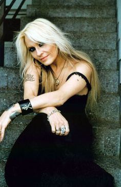 Doro Pesch..amazing artist and she's 49 years old! hope i look like that at 49.