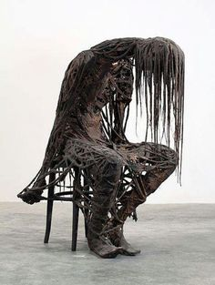 Halloween decoration - this is creepy using mop string dipped in Monster Mud and draped over a skeleton.