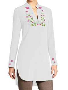 This adorable top is embroidered with multicolor flowers around the neck and sleeves and is available in various rainbow colors. Wear it with or without trouser