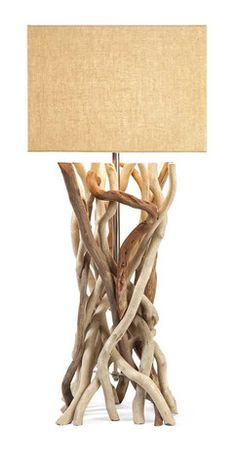IMAX Explorer Drift Wood Table Lamp - The Explorer table lamp features a base made from natural driftwood and a rectangular jute shade. This versatile style and look adapts well to a variety of decor.
