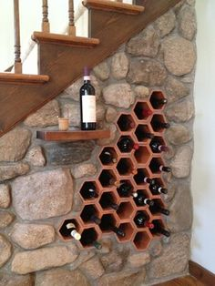 Prefer round receptacles for the wine, but like the idea of having the wine rack under the stairs, plus a little table to put a bottle on. Wine Cellar Design, Wine Rack Design, Home Wine Cellars, Wine House, Wine Storage, Storage Containers, Wall Bar, Stone Houses, Tasting Room