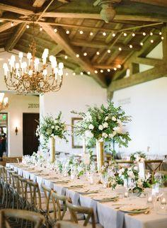 Organic greenery centerpieces: http://www.stylemepretty.com/2016/12/15/blue-gold-santa-barbara-wedding/ Photography: Michelle Beller - http://www.michellebeller.com/