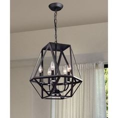 Light up your home with this Joshua Multangular Iron Chandelier in Antique Black. This 5 -light chandelier is made of iron and features a black finish that will enhance the decor style of your Black Iron Chandelier, Iron Chandeliers, 5 Light Chandelier, Light Pendant, Rustic Chandelier, Stairwell Chandelier, Globe Chandelier, Bronze Pendant, Br House
