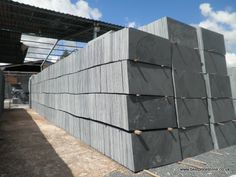 600x400mm Brazilian Black flooring slate stacked up and ready to pack into wooden crates.