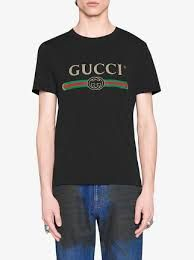 """$480.00 GUCCI - Gucci Washed T-shirt with Gucci logo - Men - SOLD by GUCCI - affiliate - Alessandro Michele brings the Gucci logo to the forefront, inspired by vintage prints from the eighties.   The retro-style motif is presented on a T-shirt style made in washed cotton jersey with small holes in the fabric for a vintage effect.  Black washed cotton jersey with Gucci vintage logo  Crew neck Straight fit  100% cotton  Made in Italy  The model is 6'2"""" and is wearing size medium"""