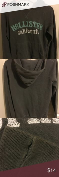 💕 Hollister hoodie Hollister pullover hoodie made of cotton and polyester. Think this was purchased as size large but may be wrong. Might fit a different size. Sleeve needs to be hemmed see picture, some spotting, and fade. Overall good shape sold as is no returns final sale Tops Sweatshirts & Hoodies