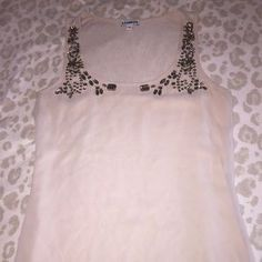 I just added this to my closet on Poshmark: Express studded tank top. Price: $20 Size: XS