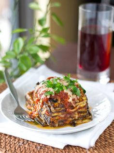Eggplant slices are dipped in egg and Parmesan then pan fried. Stack the eggplant with spoonfuls of sauce and mozzarella and broil until it is hot.