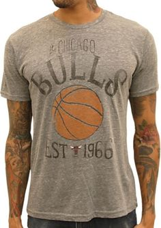 This officially licensed NBA shirt by Junk Food features print of a basketball along with the Chicago Bulls team logo and year the team was established.    Fabric Details  Color: Athletic Gray  50% polyester / 37% cotton / 13% rayon  Our Price: $25.95