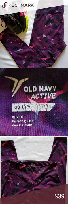 Womens Workout Sport Athletic Pants Legging Tights Women's Workout Sport Athletic Pants Legging Tights. Old Navy Plum purple Pink Floral and black design. Size XL  Fitted High Waisted Inseam 28 in. Waist 33 in. Great Pre-owned Condition  Decorative props not included. Old Navy Pants Leggings