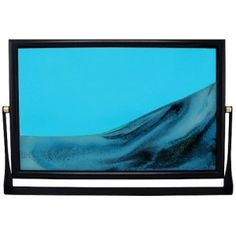 The Sand Picture - x Blue is a fascinating executive toy for your desk. Flip over the large frame on the metal swivel stand to create your own work of art. With each turn, the sand slowly shifts to reveal a new scene. Motorized Tv Lift, Executive Toys, Television Console, Plasma Tv Stands, Sand Pictures, Console Styling, Large Frames, Sand Art